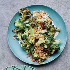 Chicago chef Stephanie Izard amps up broccoli with a punchy vinaigrette, creamy blue cheese dressing and an irresistibly crunchy, butter-toasted Rice Krispies topping. To go with the funkiness of the blue cheese in this salad, try a Farmhouse Ale. Broccoli Recipes, Vegetable Recipes, Vegetarian Recipes, Healthy Recipes, Vegetable Salads, Broccoli Salads, Steamed Broccoli, Vegan Vegetarian, Wine Recipes