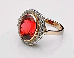 10 carat rubellite Tourmaline in a classic victorian setting with diamonds,red and white 18ct gold