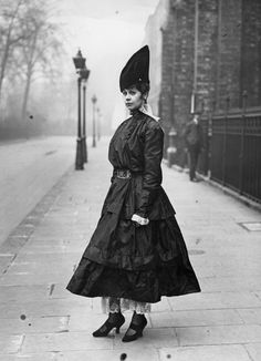 1916 | ``This lovely Victorian lady would never get lost in a crowd with this hat.``