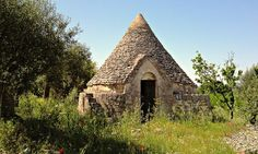 A trullo is a kind of circular stone hut that might originally have been portable. They are found mostly in Puglia, where shepherds from Benevento would go in winter.