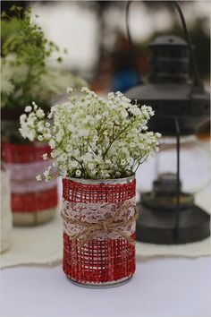 rustic lace table decoration ideas--cans with burlap, lace, jute, ribbons, raffia, etc.