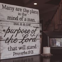 """""""The Purpose of the Lord"""" measures approximately 16""""X16"""" and is available in several wood finishes and text colors.   If you are local to ATL and would like to negate shipping charges, simply add the discount code FREEATLANTAPICKUP at checkout and Kam will message you with an address for pickin..."""