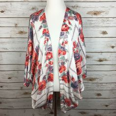 "[UO] Floral Scarf Print Kimono Boho Gypsy Festival Gorgeous kimono by Kimchi Blue from Urban Outfitters. Short dolman sleeves. Draped sides. Floral scarf print. Lightweight and breezy. The perfect layering piece for summer. Marked size XS/S. Really could fit XS-M since it's an open flowy fit!   Fabric: 100% Rayon  Length: 32"" Condition: EUC. No flaws. Like new.  No Trades! Urban Outfitters Tops"