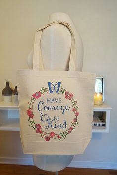 An adorable tote bag! Perfect for Disney fans or the Princess at heart! Have courage and be kind is printed inside of a floral wreath and finished