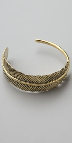@shopbop.com Monserat De Lucca gives us nature in bronze with a curved feather in it's simplicity perfection