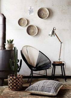 Home decor with African details like woven baskets and mud cloth pillows @pattonmelo