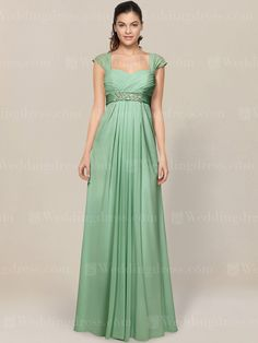 Cap sleeves mother of bride dress features a sweetheart pleated bodice with beaded sash at empire waist.