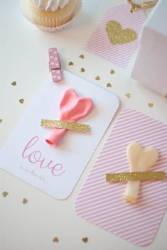 Attach Valentine's Gift Tags to box with taped  Heart Balloons by using Decorative Clothespins