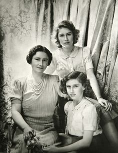 Queen Elizabeth (Queen Mum), Princess Elizabeth & Princess Margaret. This study of the family in simple dress was taken when Beaton was invited to photograph the visit of Mrs Franklin Roosevelt, the First Lady of the United States, to Buckingham Palace. It was perhaps intended to show the ordinariness of royalty, who, like other Britons, experienced food rationing during the war | Photo by Sir Cecil Beaton, October, 1942.