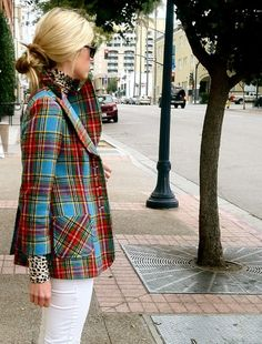 Print mixing - a leopard turtleneck with a plaid jacket, and simple white denim to ground the look.