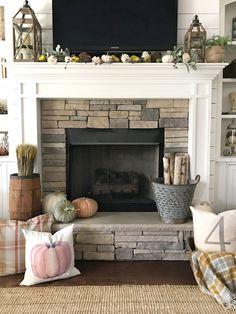 Fall Fireplace Mantel Decor. Pumpkins, pumpkin pillows, metal olive bucket, driftwood, faux pumpkins, white pumpkins Fall fireplace mantel decor #falldecor #fallmanteldecor #fall #mantel #decor Our Vintage Nest