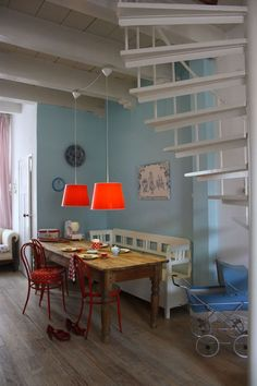 red pendant lights, blue wall, and everything else