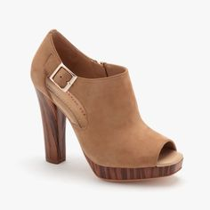 Love the natural wood soles on these peep toes!