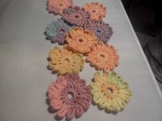 Crochet daisies,  crochet appliques, flower appliques, for scrapbooking, multi coloured, pastel colours,   set of ten,  embellishment by MaddisonsRainbow on Etsy