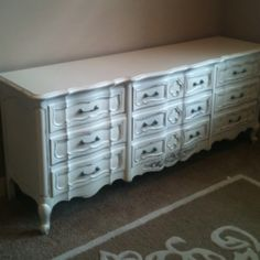 Baby girls antique refinished dresser.  Blue pulls from Anthropology