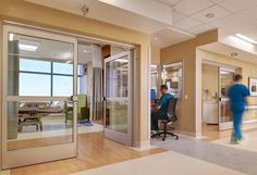PHOTO TOUR: Prebys Cardiovascular Institute | Healthcare Design --- Efficient nurse viewing stations located between two ICU patient rooms allow for improved visual monitoring. The patient rooms are large enough to allow a team of clinicians to work around the bed at all times and still accommodate furnishings for family night stays. Photo: Stephen Whalen/Courtesy of HOK