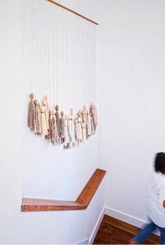 16 Affordable Design Ideas to Update Your Home in 2016 | Decorist  Have an empty stairwell? Make a #tassel wall hanging-Try @HonestlyWTF 's easy tutorial.
