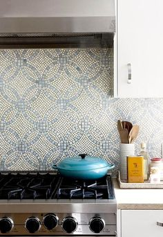 All white kitchens sometimes warrant a splash of color. Depending on your style, a patterned backsplash design is a great way to integrate texture and color into the space. We particularly love the pairing of the patterned tile by Anne Saks with the Viking range and white lacquer cabinets with stainless hardware. The combination is so timeless and is a great focal point for the space.