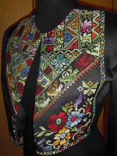 Palestinian and Jordanian women embroidery by hand all these intricate details. So much work goes into this and the result is astounding. This short jacket guarantees you can the cultural heritage with a modern twist. Ships international, available on:  http://www.ananasa.com/