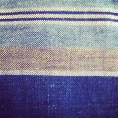 Detail of a vintage hand woven Japanese indigo fabric. Close up from a boro zip pouch www.mujostore.com