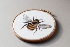 Inspired by spring flora and fungus, 21-year-old Emillie Ferris embroiders one-of-a-kind hoops that feature detailed rabbits, foxes, and mushrooms. The works are handstitched and kept on their original frame, drawing the viewer's attention to the amount of handiwork that went into each animal's coat