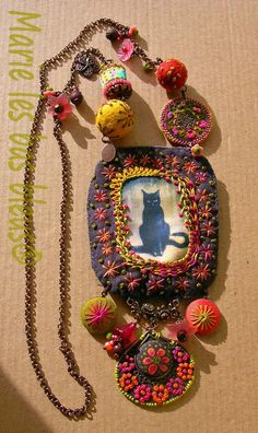 Create an assemblage necklace out of hand dyed and embroidered fabric.