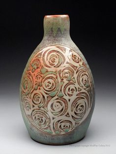 Turquoise bottle. Wheel-thrown stoneware glazed with shino, decorated with wax resist and other traditional reduction glazes. Julie Covington Ceramics, Pottery at MudFire Gallery.