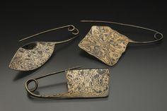 Wearable Art by Daniel Icaza, via Behance | TITLE: Mokume Gane Fibulas MEDIUM: Copper/Nickel Mokume Gane DIMENSIONS: (approx.) 6cm x 2cm x .5cm DATE: 2009