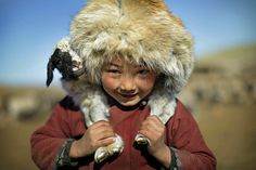 Young boy with kid. Gobi desert, Mongolia.  Photo by Timothy Allen.
