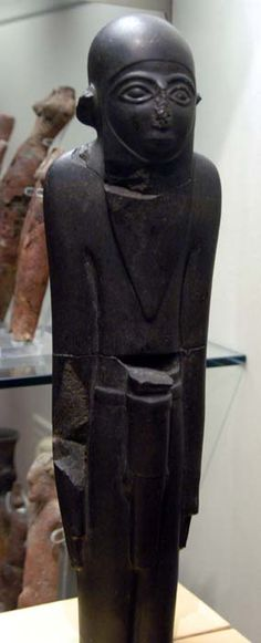MacGregor Man Statuette (c.3100 B.C.) basalt, Egypt, Predynastic, Naqada - once in the collection of the Rev. William MacGregor and named for him.