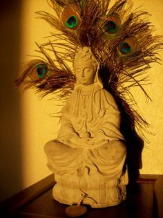 Quan Yin with peacock feathers