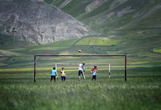 soccer (or football), field of grass, mountains in the background...what's not to love?