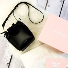 """Mansur Gavriel Mini Mini Bucket Bag This authentic Argento/Black Mansur Gavriel bag is the perfect gift for yourself or a friend. Comes with box and dust bag. Italian vegetable tanned black leather mini mini bucket bag with silver interior metallic patent. Adjustable strap. Made in Italy. 8"""" H X 6"""" W X 3.75"""" D Mansur Gavriel Bags Mini Bags"""