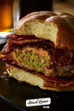 Bacon-Guac Stuffed Sausage Burger   A plate full of Wholly Guacamole bacon deliciousness.   Black Label® Bacon