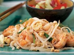 Shrimp Pad Thai - Make Thailand's most popular noodle dish in mere minutes. This lightened version is packed with vibrant ingredients such as crushed red pepper, sliced green onions, and dry-roasted peanuts to add great Thai flavor. Thai Recipes, Seafood Recipes, Asian Recipes, Dinner Recipes, Healthy Recipes, Chinese Recipes, Healthy Eats, Yummy Recipes, Dinner Ideas
