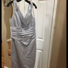 Brides maid dress beautiful long dress used once- excellent condition! im 5'5 tall & length is bout 5'6 in length. you can also get it shorten if desired as short dress. NEGOTIABLE- MAKE ME AN OFFER David's Bridal Dresses