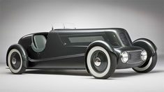 "Edsel Ford's 1934 Model 40 Speedster.  Beautiful classic car displayed at the annual Pebble Beach Concours d'Elegance, in California.    ""Inspired by European rides of the late '20s and early '30s and drawn by Ford's chief designer E.T. Gregorie, the Speedster was based on a 1934 Ford frame but underwent major surgery to appear longer and lower, and has recently been restored to its original specifications, making it as authentic as any 1940 model could reasonably be."""