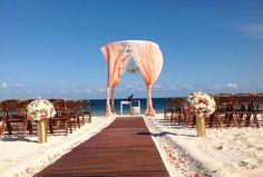 Peach drapes wedding hoopa on the beach