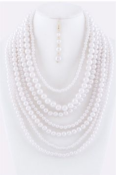 Seven strands Necklace and Earrings set //faux pearls // 7 inches drop // Metal // lobster-clasp closure.  Size : Shortest strand 18 inches, longest strand 33 inches, 3 1/2 inches extender of chain. Colors: White/ Gold plated. *Earrings: 2 1/2 inches drop approx.*