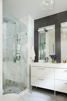 Small Scale Subway Tile offsets the white marble of this beautiful bathroom