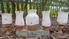 Make Tuscan-style vases out of dollar store vases!