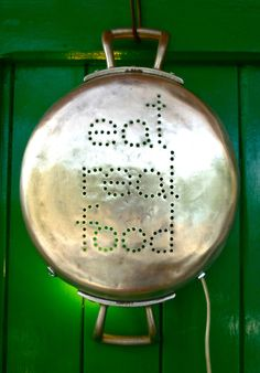 EAT REAL FOOD Upcycled light made from old pan with words punched with light behind it