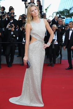 The model looked like a goddess in a shimmering cutout gown and Chopard jewels as she walked the red carpet for The Little Prince.