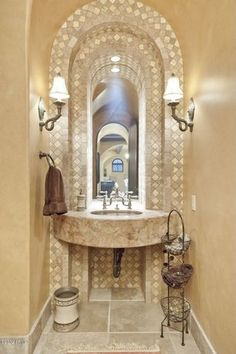 Traditional Powder Room with limestone tile floors, Limestone counters, Undermount Sink, specialty door, Powder room