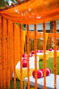genda flower strings with boulsters, setty seating, circular seating on raised gaddas