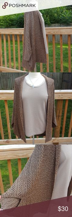 Batwing poncho  (M) Brand new with tags. Batwing poncho with several different shades of color throughout. Mainly browns and a vibrant white that gives it a bit of sparkle. Dana Buchman Sweaters Shrugs & Ponchos