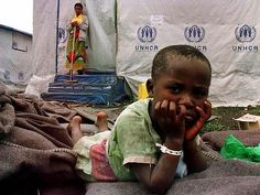 A refugee child, separated from her parents, waits at a camp in Africa. Photo: Reuters
