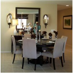 Mirror idea for dining room wall. Mirrors make the space look so much larger!