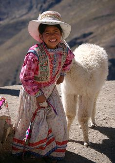 Little girl and baby alpaca. Photograph by RicardMN Photography