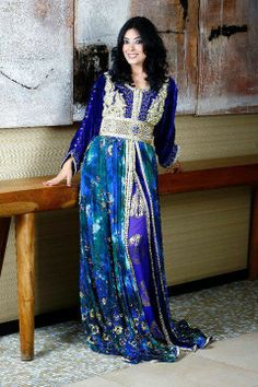 Caftan 2013 - I love the rich blues, greens and the purple colors in this outfit, but I would get rid of the overpowering wide silver belt in order to show off the purple dress underneath.